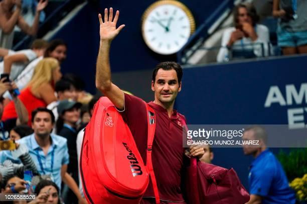 TOPSHOT Switzerland's Roger Federer waves as he walks off court after losing his 2018 US Open Men's Singles tennis match against Australia's John...