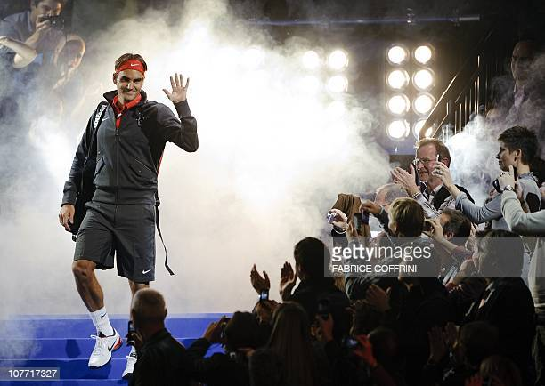 Switzerland's Roger Federer waves to spectators as he arrives to play against Spain's Rafael Nadal during a charity game on December 21 2010 in...