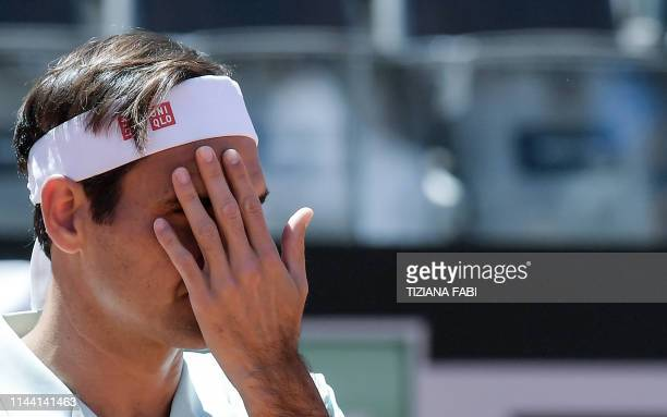 Switzerland's Roger Federer wipes his face during his ATP Masters tournament tennis match against Portugal's Joao Sousa at the Foro Italico in Rome...