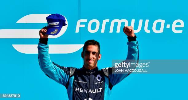 Switzerland's Sebastien Buemi with Renault celebrates on the podium after placing first in the Berlin leg of the Formula E electric car Championships...