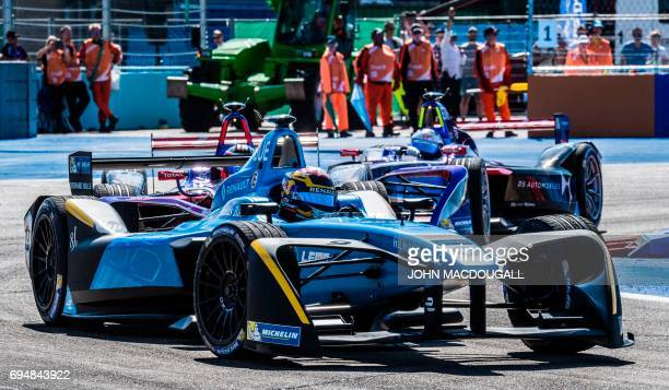 Switzerland's Sebastien Buemi with Renault is pictured on his way to winning the Berlin leg of the Formula E electric car Championships on June 11...