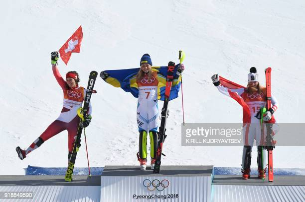 Switzerland's second place winner Wendy Holdener Sweden's winner Frida Hansdotter and Austria's third place winner Katharina Gallhuber pose on the...