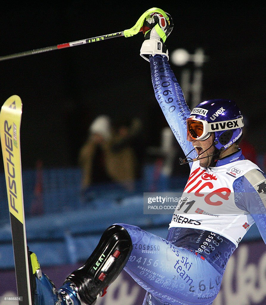 Switzerland's Silvan Zurbriggen jubilates in the finish area after taking the second place in the World Cup men's slalom competition in Sestriere 13 December 2004. U.S. Bode Miller won the competition while Finnish Kalle Palander took the third place. AFP PHOTO/Paolo COCCO