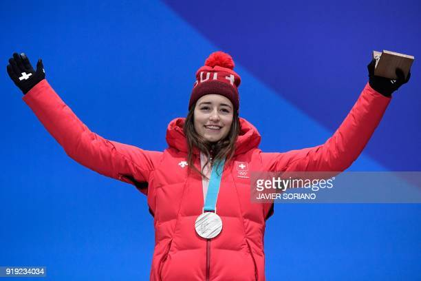 Switzerland's silver medallist Mathilde Gremaud poses on the podium during the medal ceremony for the freestyle skiing women's ski slopestyle at the...