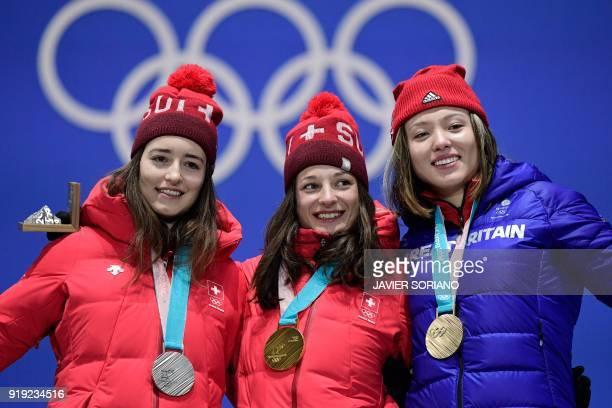 Switzerland's silver medallist Mathilde Gremaud, Switzerland's gold medallist Sarah Hoefflin and Britain's bronze medallist Isabel Atkin pose on the...