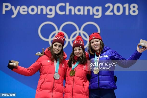 Switzerland's silver medallist Mathilde Gremaud Switzerland's gold medallist Sarah Hoefflin and Britain's bronze medallist Isabel Atkin pose on the...