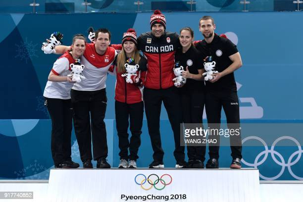 Switzerland's silver medallists Jenny Perret and Martin Rios Canada's gold medallists Kaitlyn Lawes and John Morris and Russia's bronze medallists...