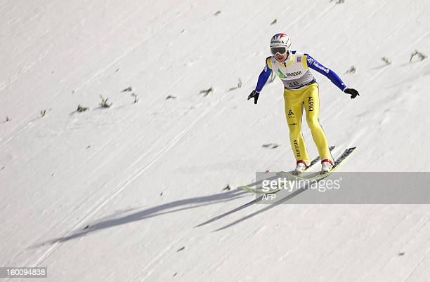 Switzerland's Simon Ammann jumps during the first run of the FIS Ski Jumping World Cup in Vikersund Norway on January 26 2013 AFP PHOTO /SCANPIX/...