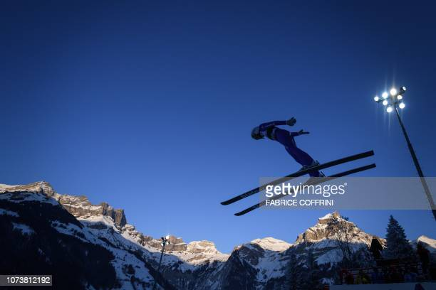 Switzerland's Simon Ammann soars through the air during the men's FIS Ski Jumping World Cup competition in Engelberg, central Switzerland, on...