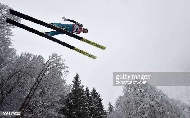 Switzerland's Simon Ammann soars through the air during the qualifying round of the individual competition at the skiflying world championships on...