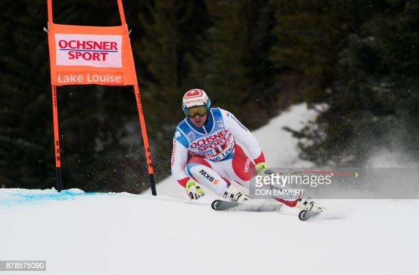 Switzerland's ski racer Beat Feuz carves a turn during a training run for the FIS Ski World Cup November 24 2017 in Lake Louise Alberta / AFP PHOTO /...