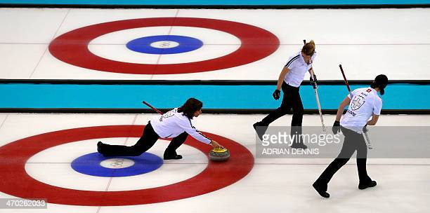 Switzerland's Skip Mirjam Ott throws the stone during the Women's Curling Semifinal against Sweden at the Ice Cube Curling Center during the Sochi...
