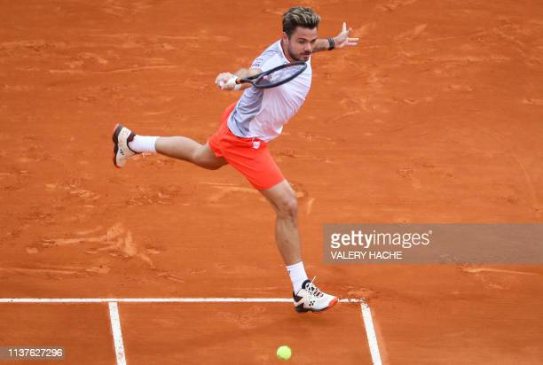 Switzerland's Stan Wawrinka plays a backhand return to Italy's Marco Cecchinato during their tennis match on the day 4 of the Monte-Carlo ATP Masters...