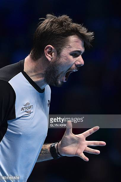 Switzerland's Stan Wawrinka reacts after a point against Britain's Andy Murray during their round robin stage men's singles match on day six of the...