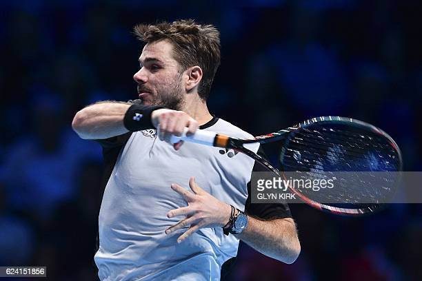 Switzerland's Stan Wawrinka returns against Britain's Andy Murray during their round robin stage men's singles match on day six of the ATP World Tour...