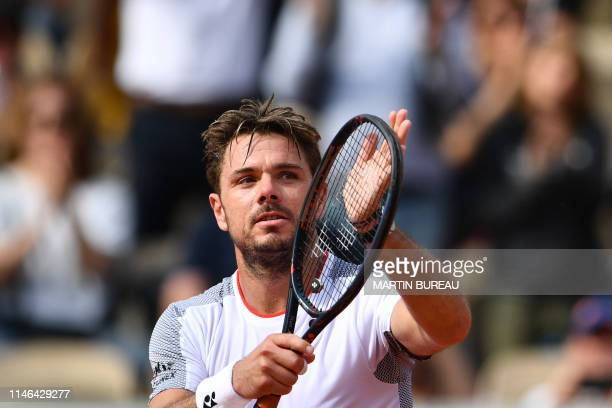 Switzerland's Stanislas Wawrinka celebrates after winning against Slovakia's Jozef Kovalik at the end of their men's singles first round match on day...