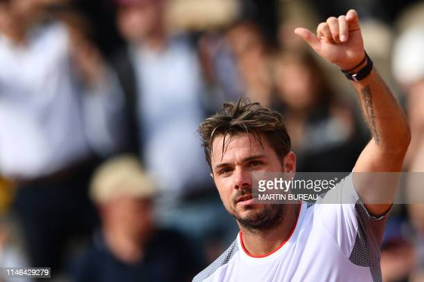 TOPSHOT Switzerland's Stanislas Wawrinka celebrates after winning against Slovakia's Jozef Kovalik at the end of their men's singles first round...