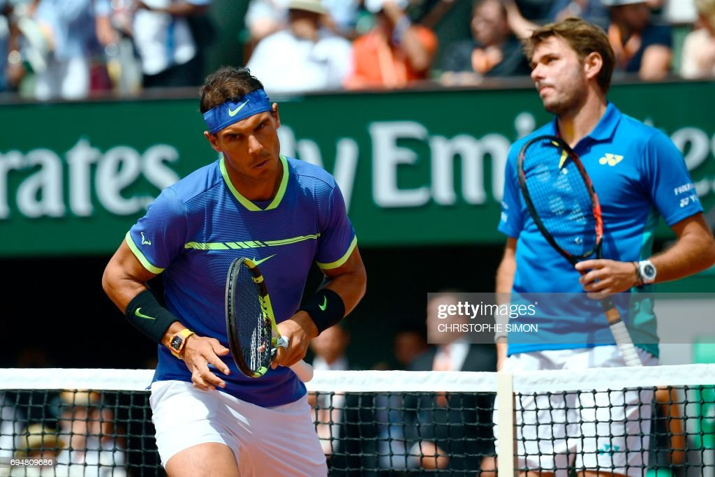 Switzerland's Stanislas Wawrinka looks on next to Spain's Rafael Nadal during the men's final tennis match at the Roland Garros 2017 French Open on June 11, 2017 in Paris. /