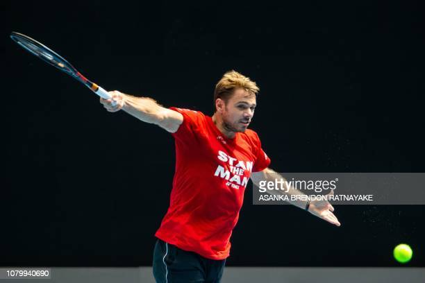 Switzerland's Stanislas Wawrinka plays a backhand shot during a practice session in Melbourne on January 10 ahead of the Australian Open tennis...