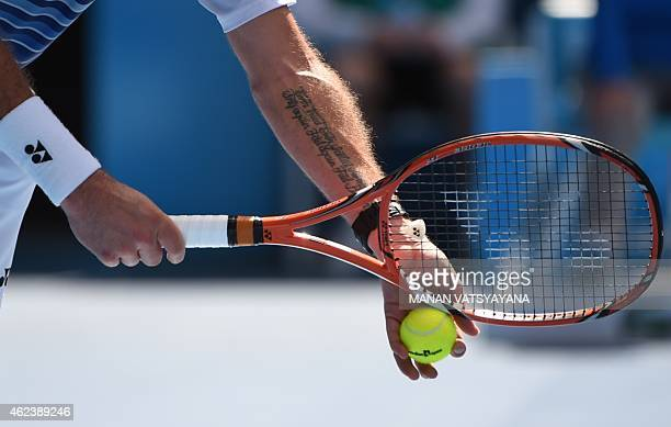 Switzerland's Stanislas Wawrinka prespares to serve during his men's singles match against Japan's Kei Nishikori on day ten of the 2015 Australian...