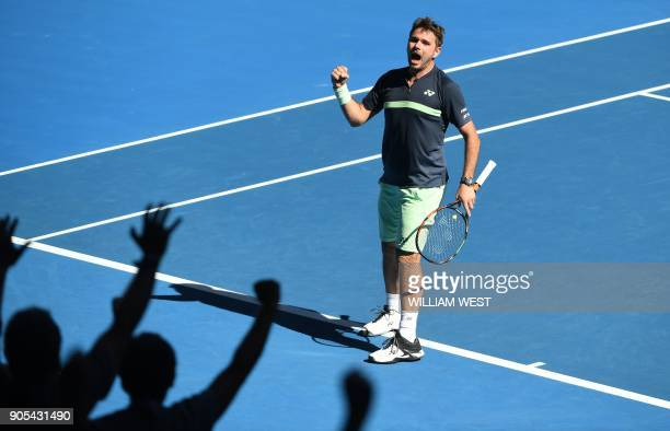 TOPSHOT Switzerland's Stanislas Wawrinka reacts after a point against Lithuania's Ricardas Berankis during their men's singles first round match on...