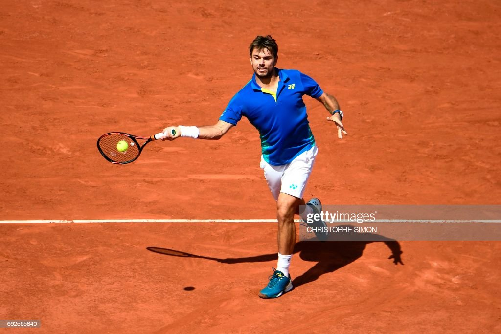 Switzerland's Stanislas Wawrinka returns the ball to France's Gael Monfils during their tennis match at the Roland Garros 2017 French Open on June 5, 2017 in Paris. /