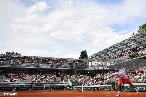 Switzerland's Stanislas Wawrinka returns the ball to Slovakia's Jozef Kovalik during their men's singles first round match on day two of The Roland...