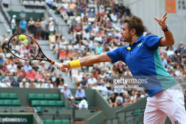 Switzerland's Stanislas Wawrinka returns the ball to Slovakia's Jozef Kovalik during their tennis match at the Roland Garros 2017 French Open on May...