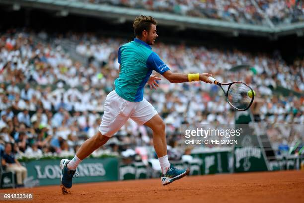 Switzerland's Stanislas Wawrinka returns the ball to Spain's Rafael Nadal during the men's final tennis match at the Roland Garros 2017 French Open...