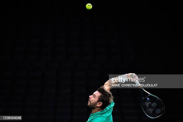 Switzerland's Stanislas Wawrinka serves the ball to Britain's Daniel Evans during their men's singles first round tennis match on day 2 at the ATP...