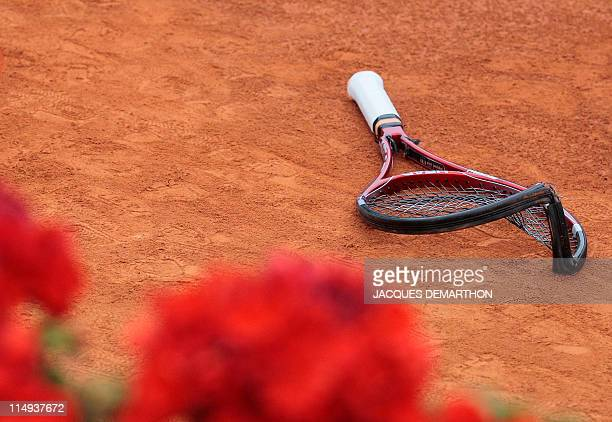 Switzerland's Stanislas Wawrinka's broken racket is displayed during his match against France's JoWilfried Tsonga during the French Open tennis...