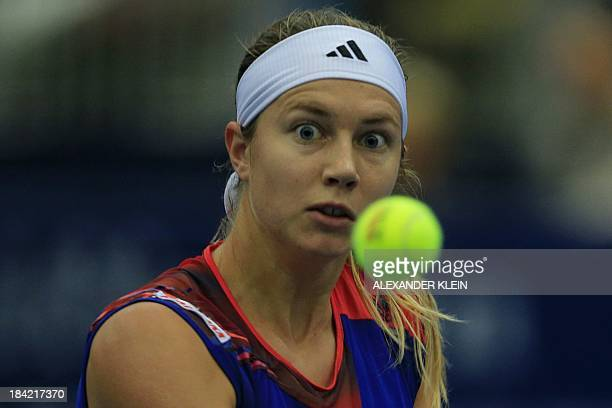 Switzerland's Stefanie Voegele eyes the ball as she plays against Serbia's Ana Ivanovic during their semi final match of the WTA tennis tournament in...