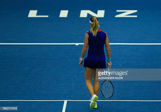 Switzerland's Stefanie Voegele walks over the court as she plays against Serbia's Ana Ivanovic during their semi final match of the WTA tennis...
