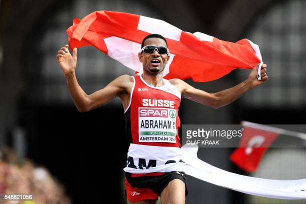 Switzerland's Tadesse Abraham reacts after crossing the finish line to win the gold medal the Men's Half Marathon during the European Athletics...