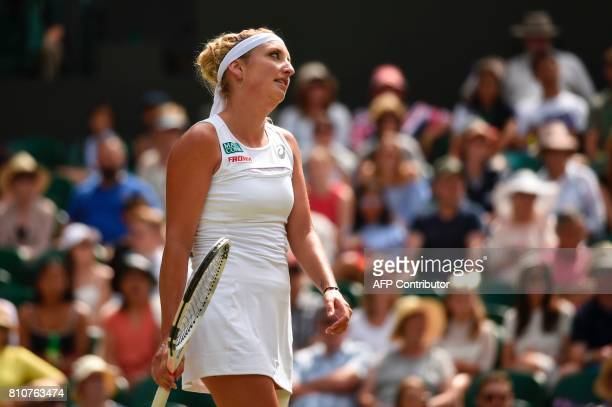 Switzerland's Timea Bacsinszky reacts after a point against Poland's Agnieszka Radwanska during their women's singles third round match on the sixth...