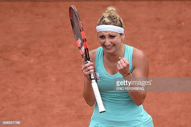 Switzerland's Timea Bacsinszky reacts after winning her women's fourth round match against the US's Venus Williams at the Roland Garros 2016 French...