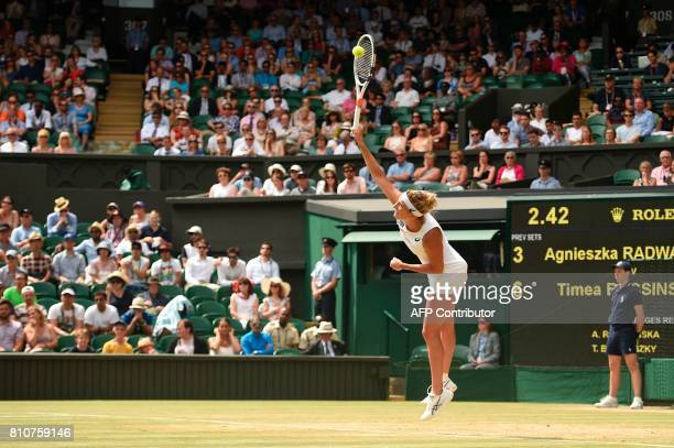 Switzerland's Timea Bacsinszky serves against Poland's Agnieszka Radwanska during their women's singles third round match on the sixth day of the...