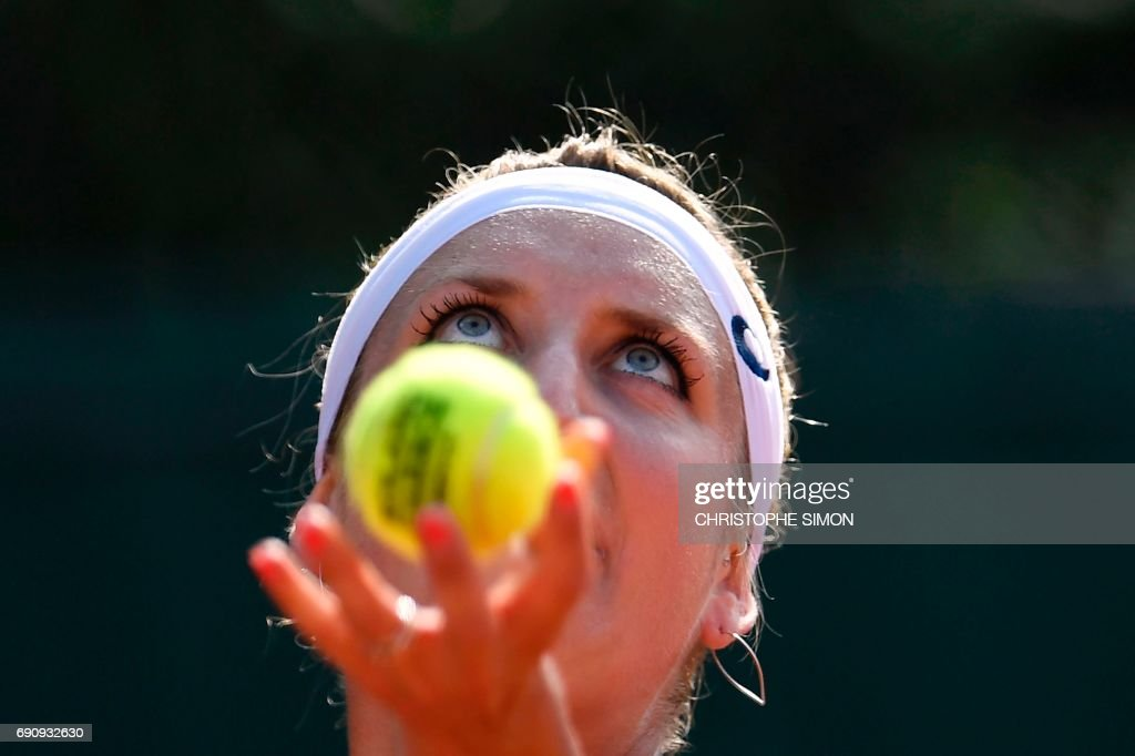 Switzerland's Timea Bacsinszky serves the ball to US Madison Brengle during their tennis match at the Roland Garros 2017 French Open on May 31, 2017 in Paris. /