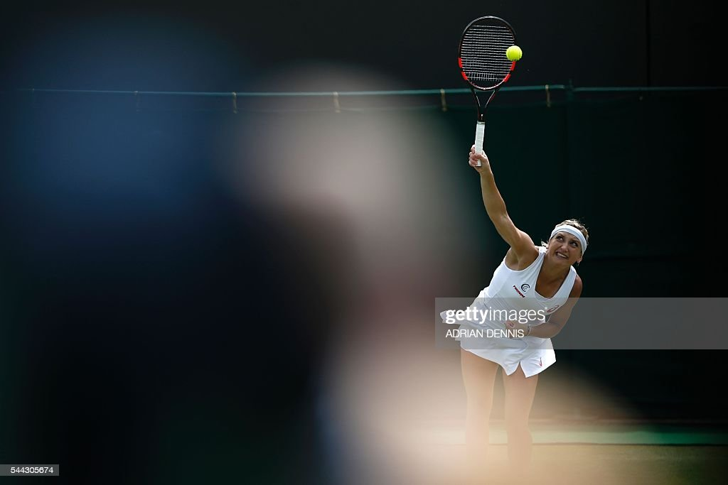 TOPSHOT - Switzerland's Timea Bacsinszky serves to Russia's Anastasia Pavlyuchenkova during their women's singles third round match on the seventh day of the 2016 Wimbledon Championships at The All England Lawn Tennis Club in Wimbledon, southwest London, on July 3, 2016. / AFP / ADRIAN