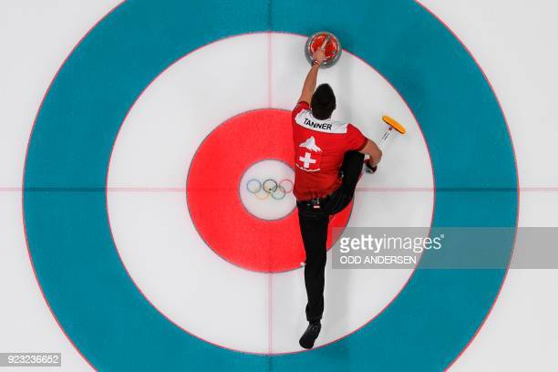 TOPSHOT Switzerland's Valentin Tanner throws a stone during the curling men's bronze medal game during the Pyeongchang 2018 Winter Olympic Games at...