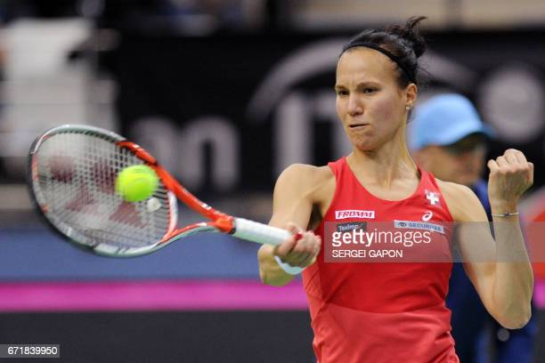 Switzerland's Viktorija Golubic hits a return to Belarus' Aryna Sabalenka during the semifinals of the Fed Cup tennis competition between Belarus and...