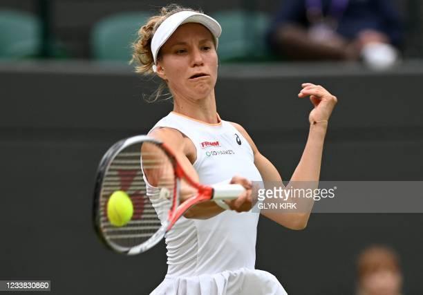 Switzerland's Viktorija Golubic returns against Czech Republic's Karolina Pliskova during their women's quarter-final tennis match on the eighth day...