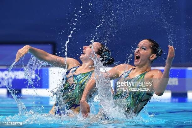 Switzerland's Vivienne Koch and Switzerland's Joelle Peschl compete in the final of the Duet Technical Artistic Swimming event during the LEN...