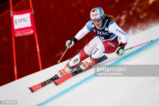 Switzerland's Wendy Holdener clears a gate during the first of the Women's giant slalom race at the FIS Alpine Skiing World Cup on January 27 2018 in...