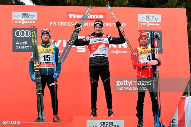 Switzerland's winner Dario Cologna poses on the podium with secondplaced Norwey's Martin Johnsrud Sundby and thirdplaced Canada's Alex Harvey during...