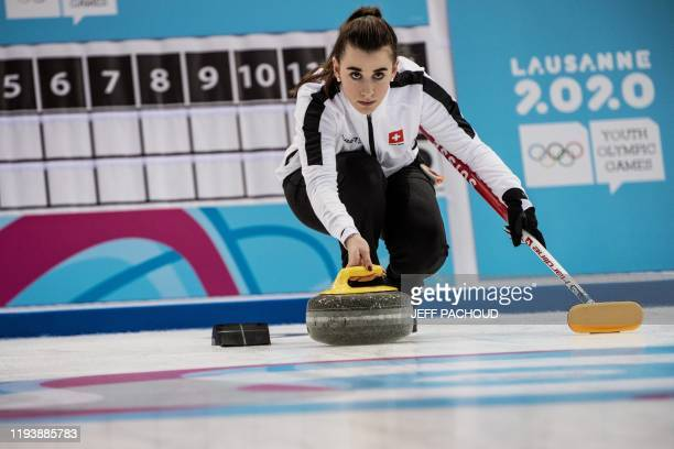 Switzerlands Xenia Schaller competes in the curling mixed team quarter-final match between Russia and Switzerland as part of the Winter Youth Olympic...