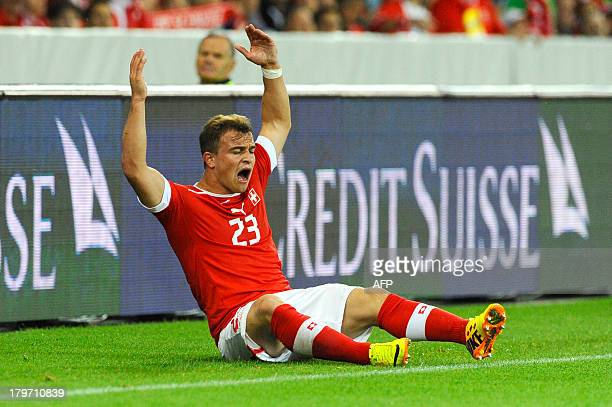 Switzerland's Xhredan Shaqiri reacts during the FIFA World Cup 2014 qualifying football match between Switzerland and Iceland at the Stade de Suisse...