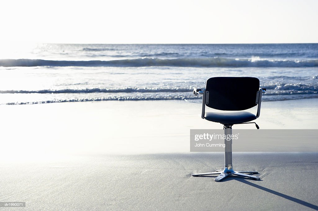 Swivel Chair on a Beach by the Sea : Stock Photo