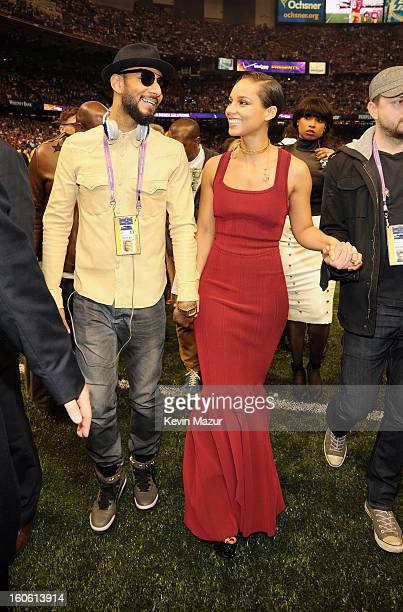 Swizz Beatz and singer Alicia Keys attend the Pepsi Super Bowl XLVII Pregame Show at MercedesBenz Superdome on February 3 2013 in New Orleans...