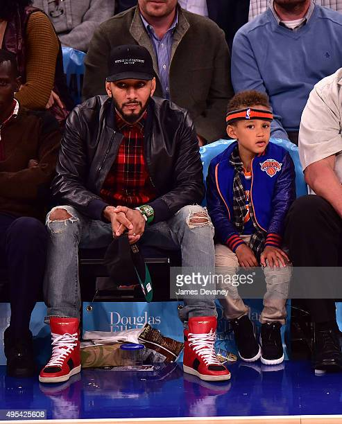 Swizz Beatz and son Egypt Dean attend the San Antonio Spurs vs New York Knicks game at Madison Square Garden on November 2 2015 in New York City
